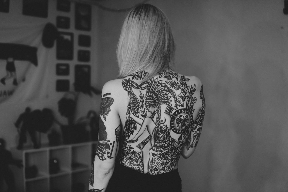 woman in black and white floral long sleeve shirt