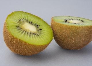 sliced green fruit on white surface