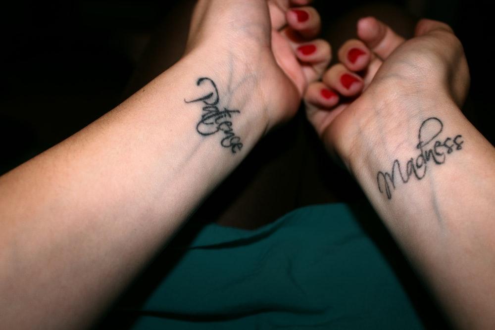 black tattoo on persons wrist