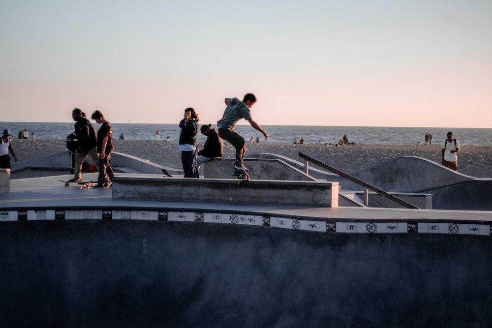 man in black t-shirt and black shorts running on gray concrete bridge during daytime