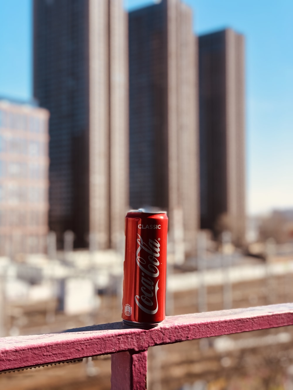 coca cola can on red table