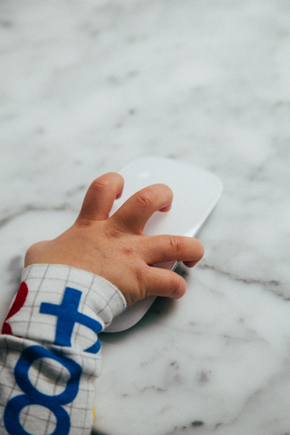 persons hand on white heart shaped paper