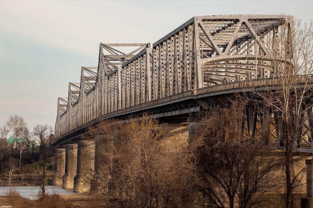 gray metal bridge under gray sky