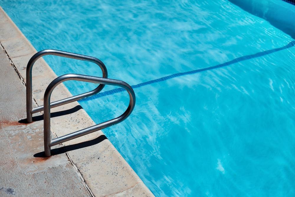 stainless steel railings beside swimming pool