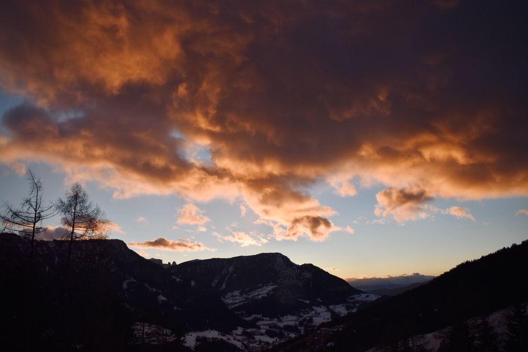 Backlit salmon clouds after a sunset in the alps.