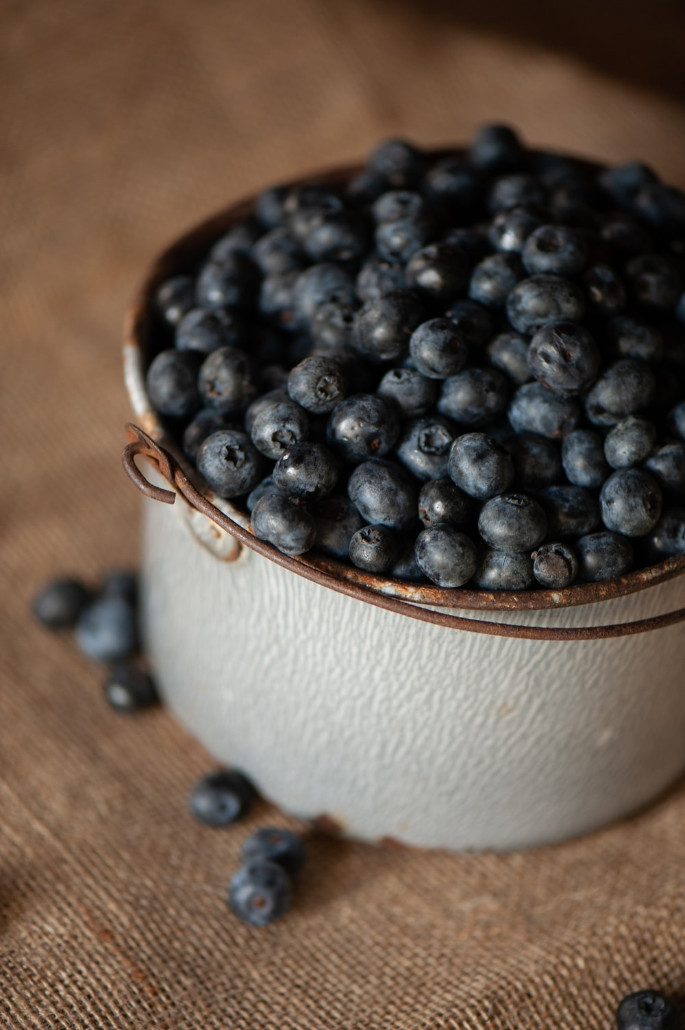 black berries in white round ceramic bowl