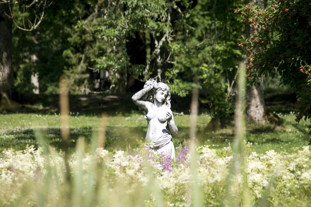 woman in white dress statue on water