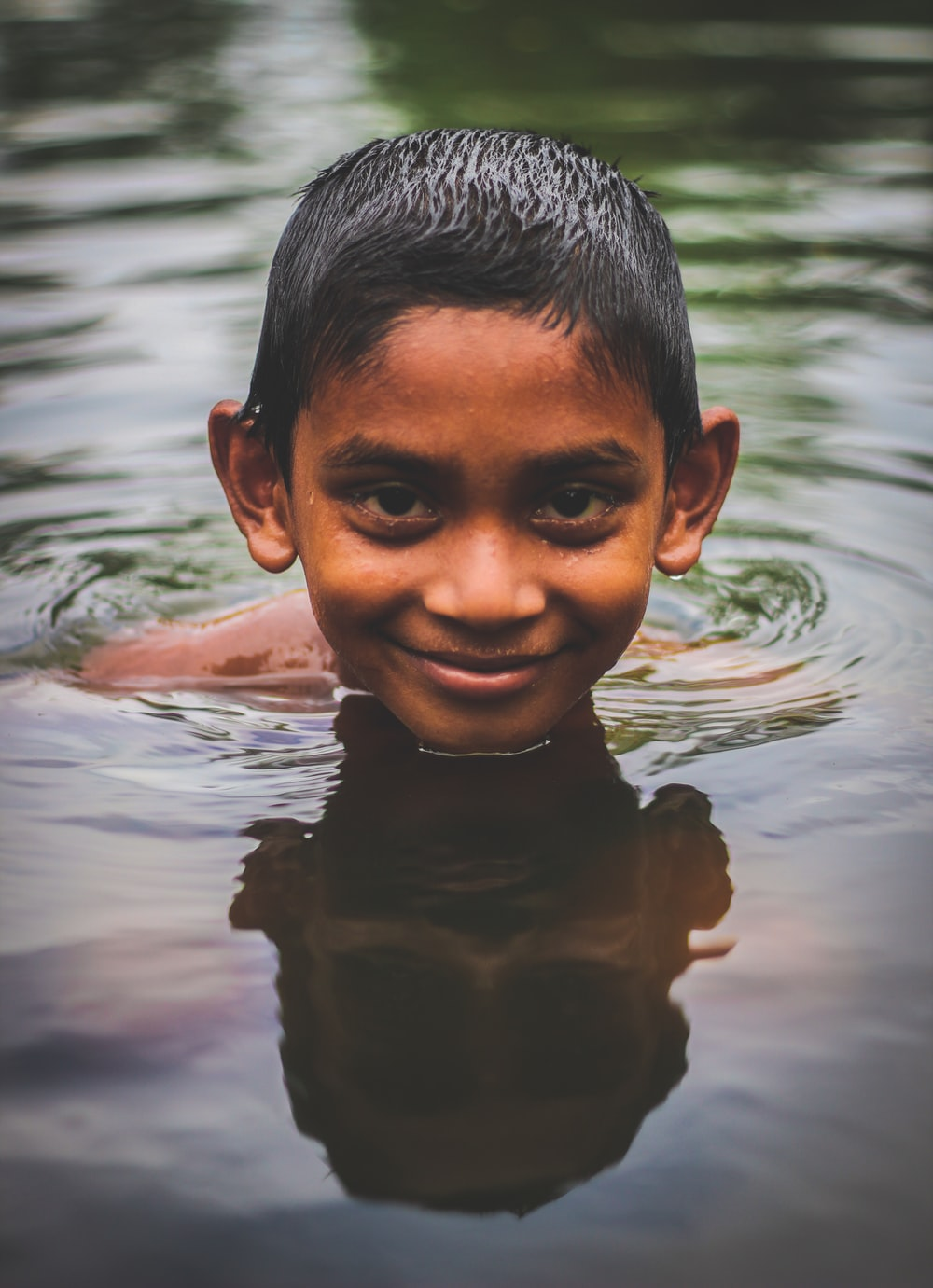 boy in water during daytime