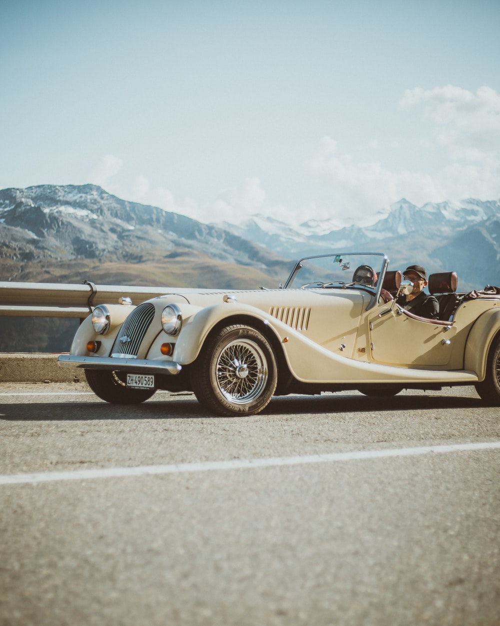 gold convertible coupe on road during daytime