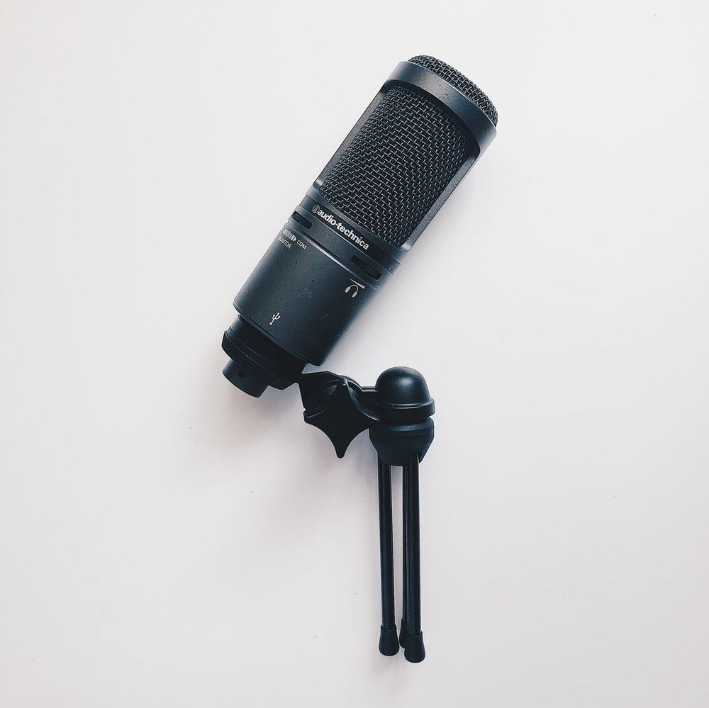 black microphone on white surface