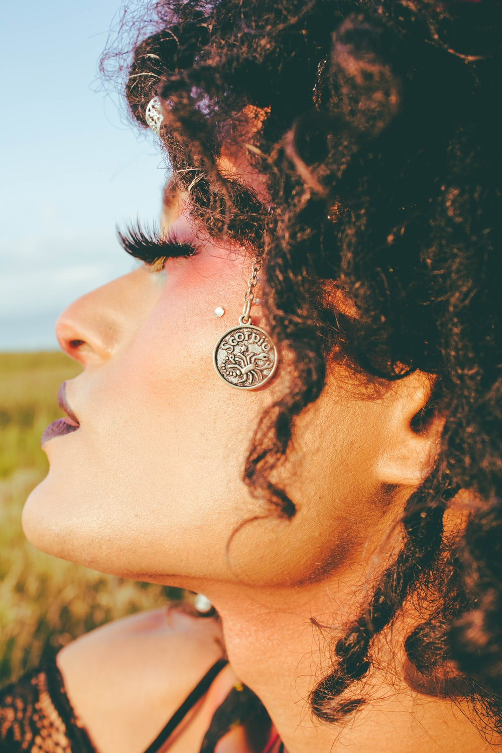 woman with black hair and silver stud earrings