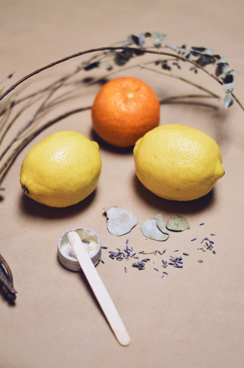 yellow lemon fruit beside silver fork on white and blue floral textile