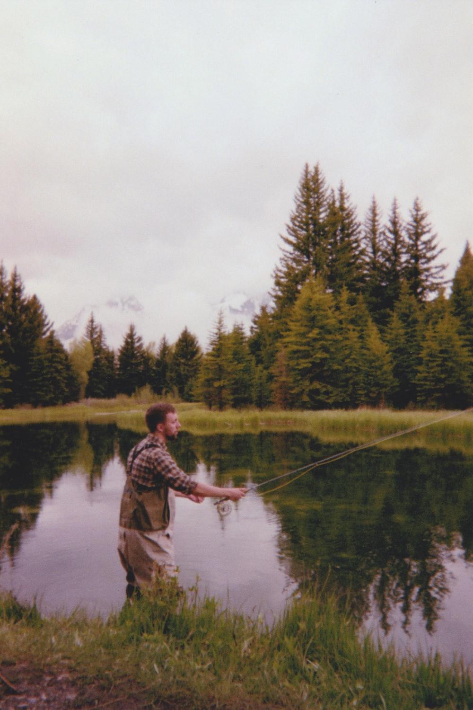 man fishing on lake during daytime
