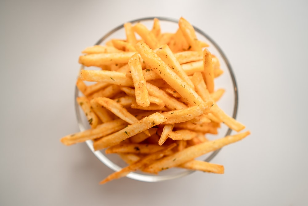 french fries on white ceramic plate