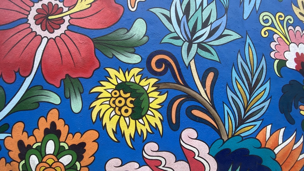 blue yellow and red floral textile