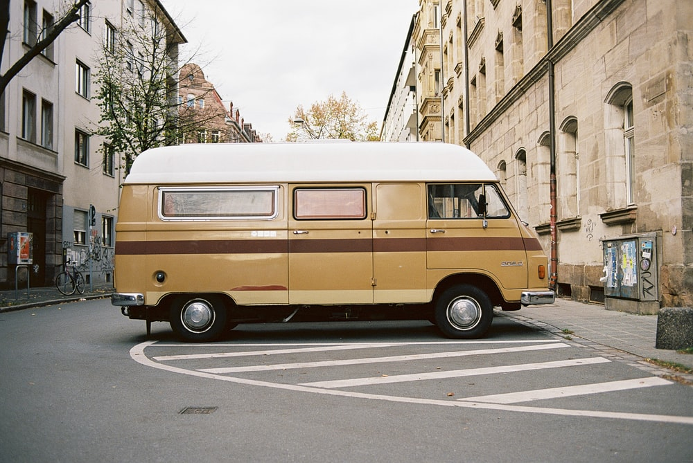 brown van parked on the side of the road