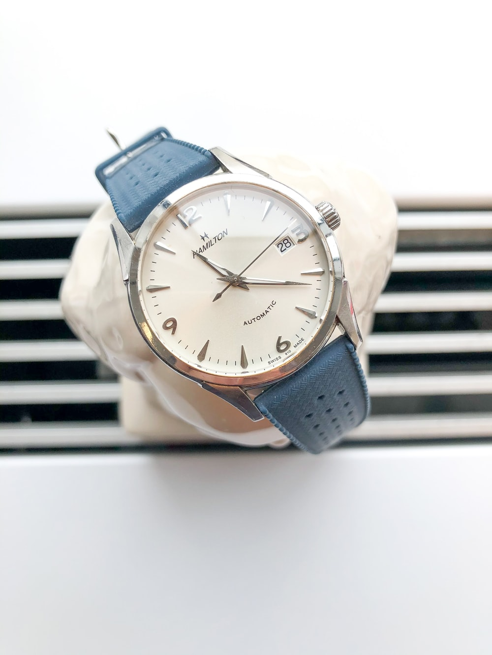 blue and silver analog watch at 10 00