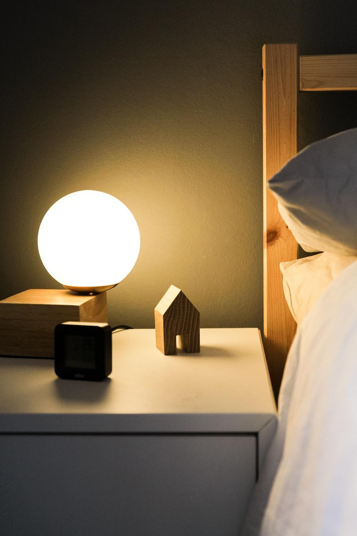 black digital alarm clock at 11 00