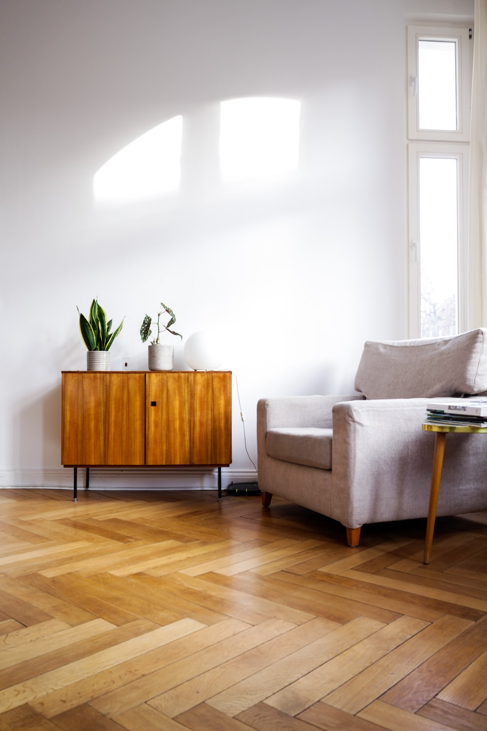 brown wooden table beside gray couch