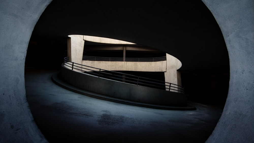 white and black boat on body of water