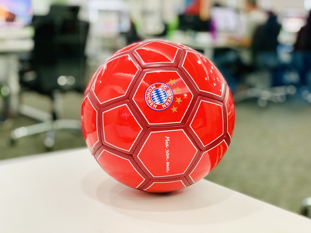 red soccer ball on white table