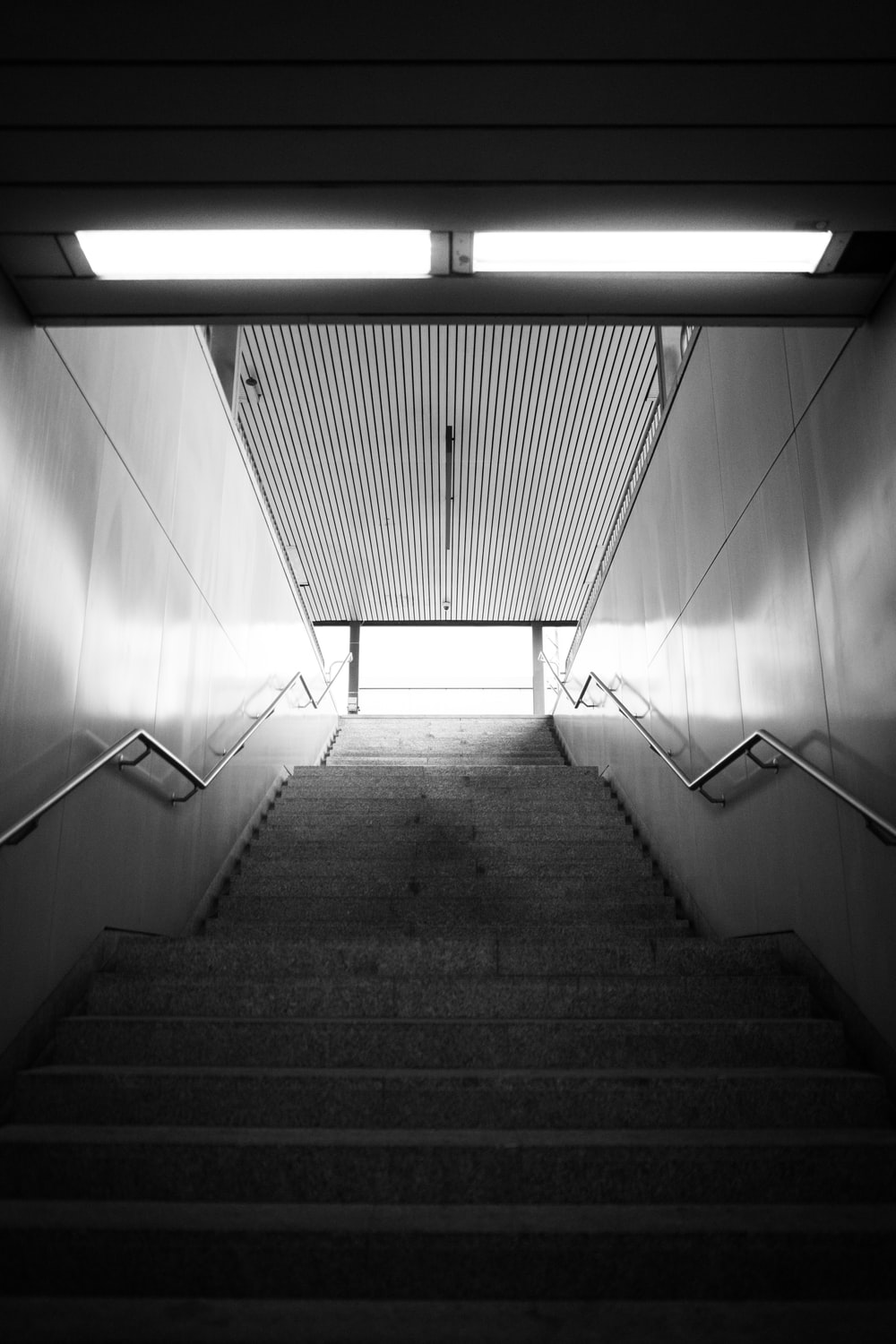 grayscale photo of empty staircase