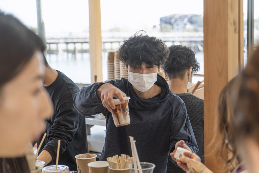 man in mask in cafe, pandemic shaming
