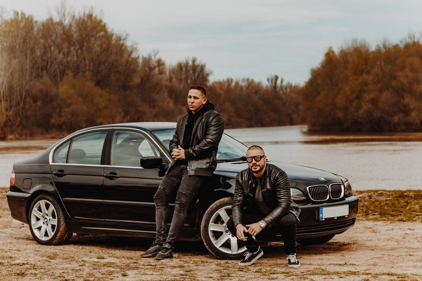 Two guys next to a car