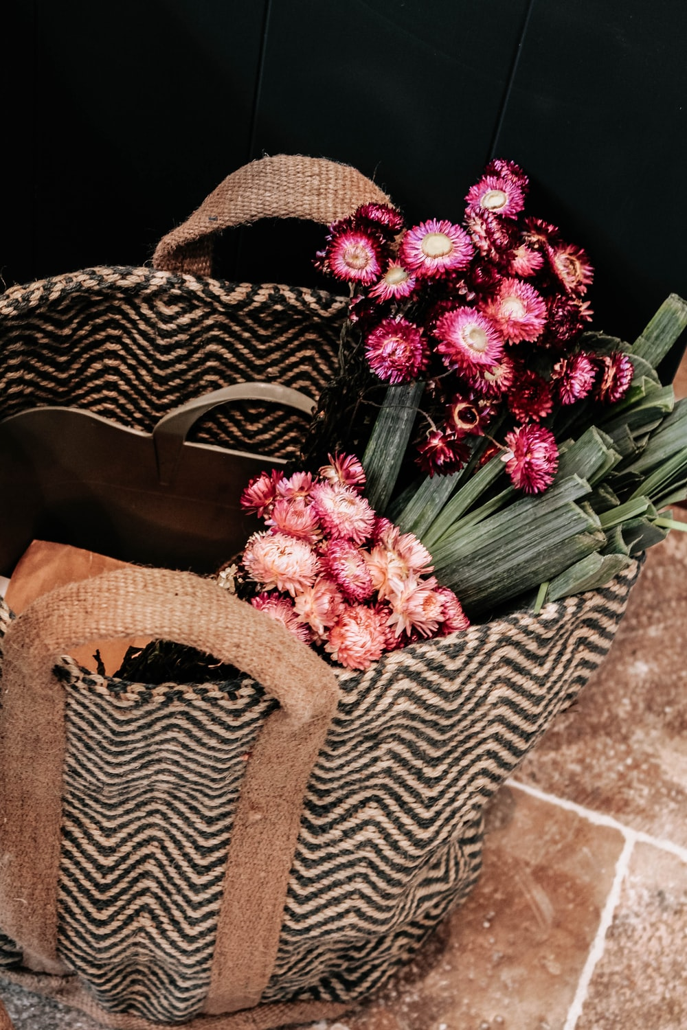 pink and white flower bouquet on brown woven basket
