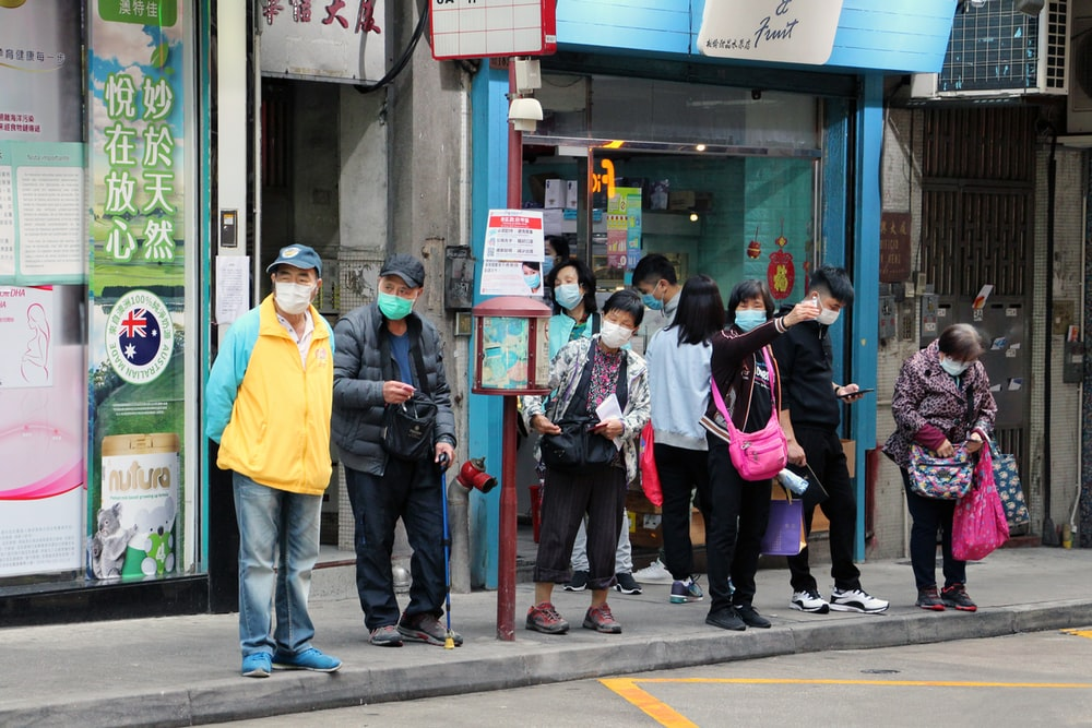 people standing in front of store during daytime