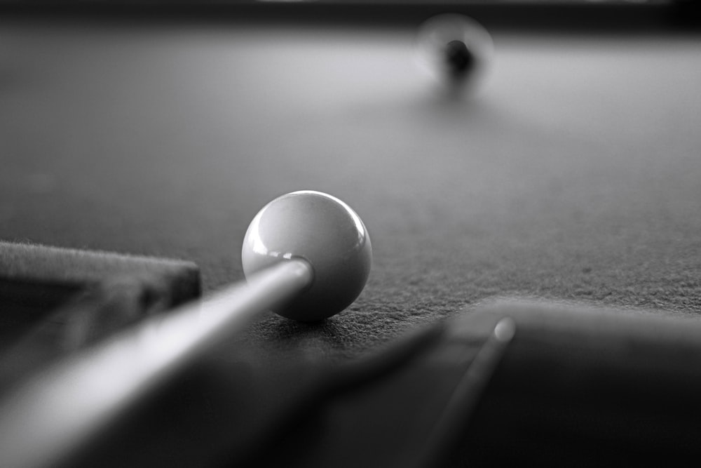 white round ball on black table