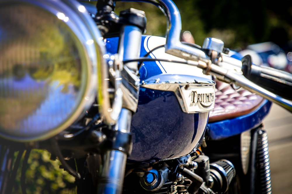 blue and silver motorcycle with blue and silver motorcycle