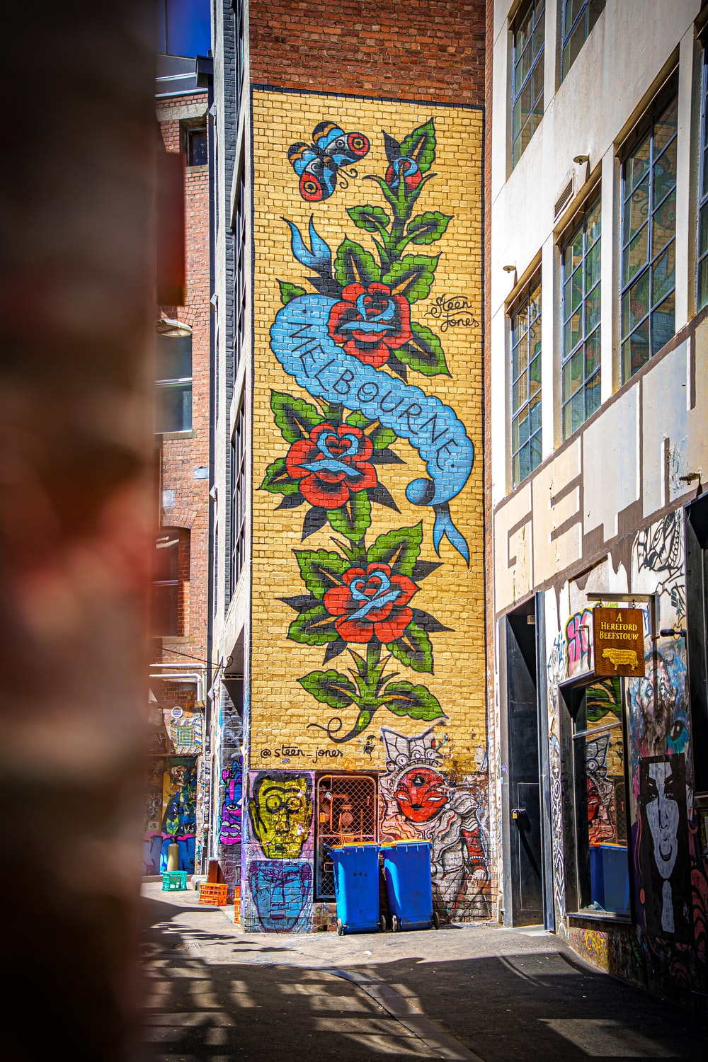 red yellow and blue graffiti on building
