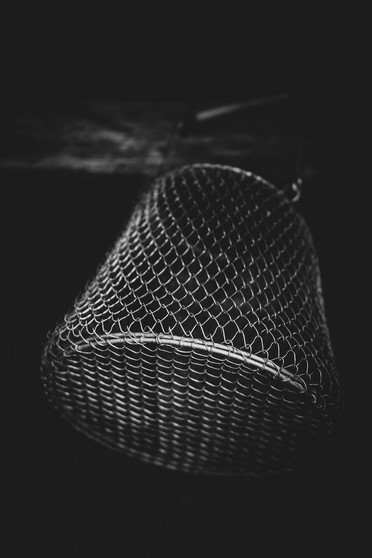 black and white round wicker basket