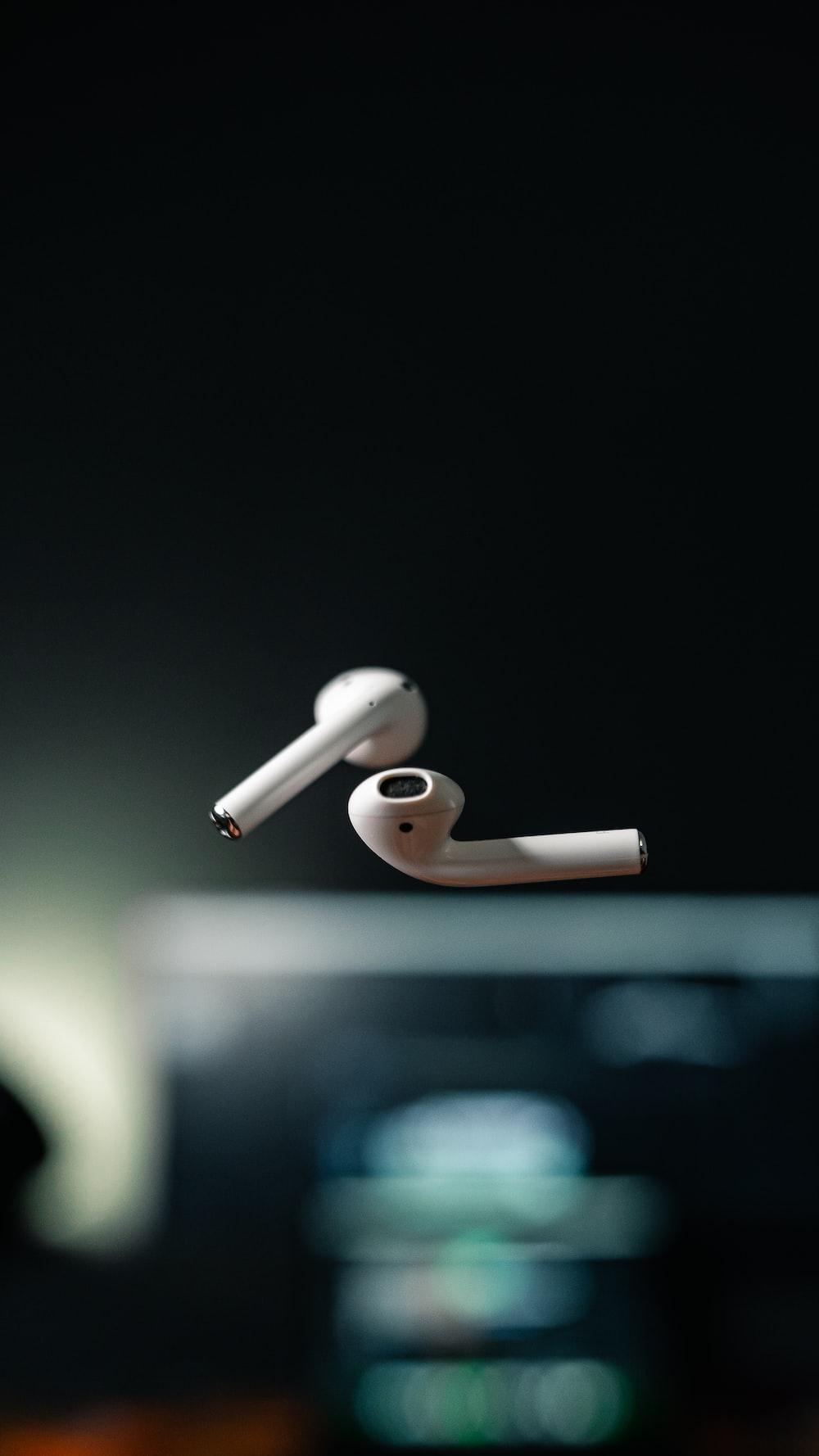 white apple earpods on black background