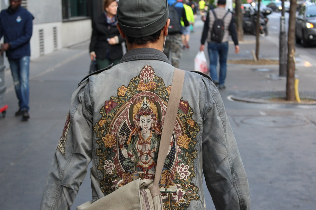 Beautiful embroidery on the jacket of a stylish man walking in Paris 🇫🇷