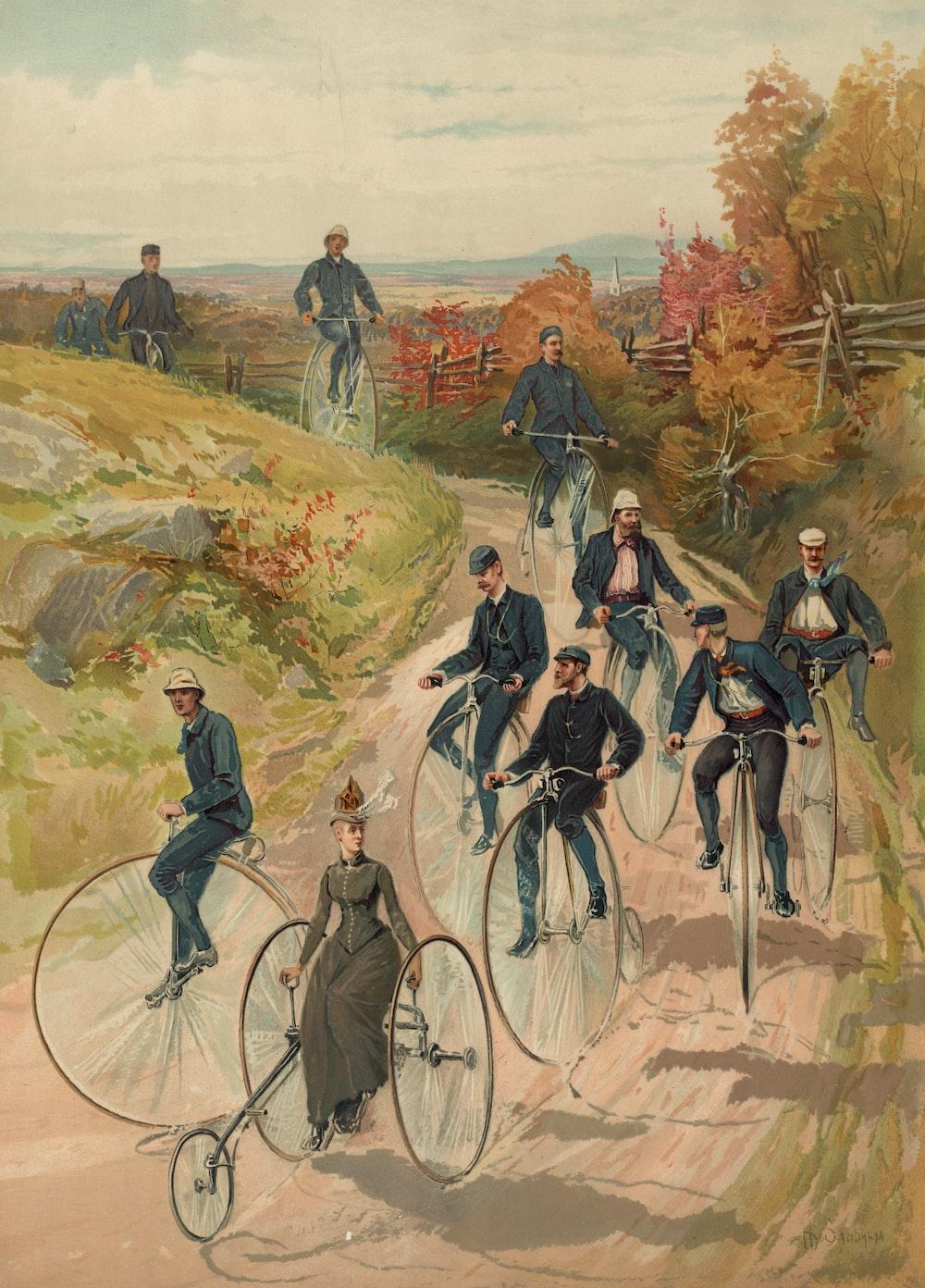 Woman, on three wheel bicycle, followed by men on high-wheelers.