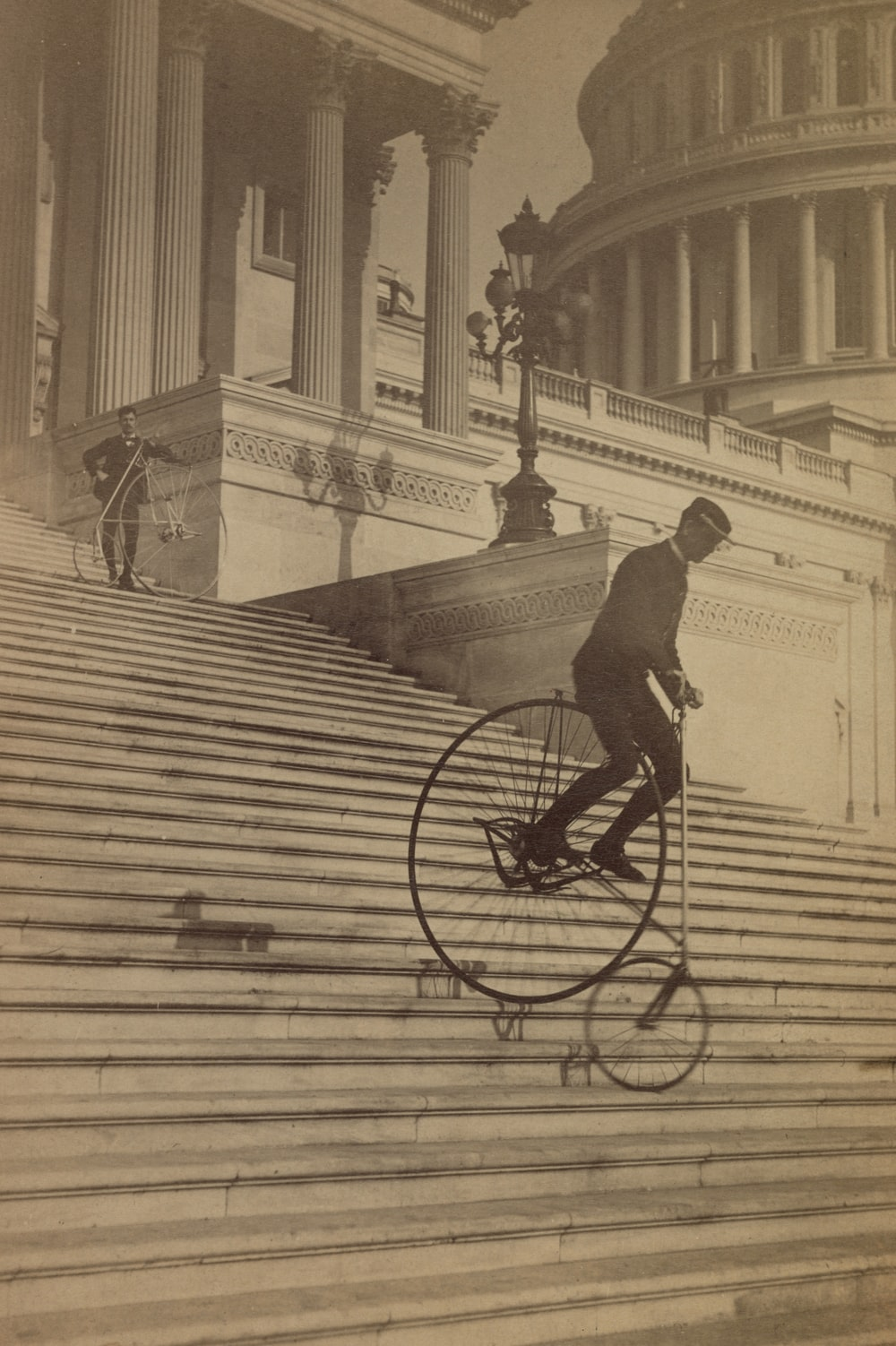 Man riding a bicycle down the steps of the U.S. Capitol