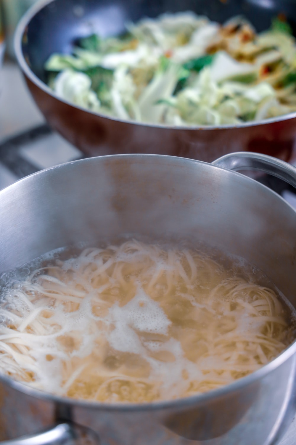 white noodles in stainless steel bowl