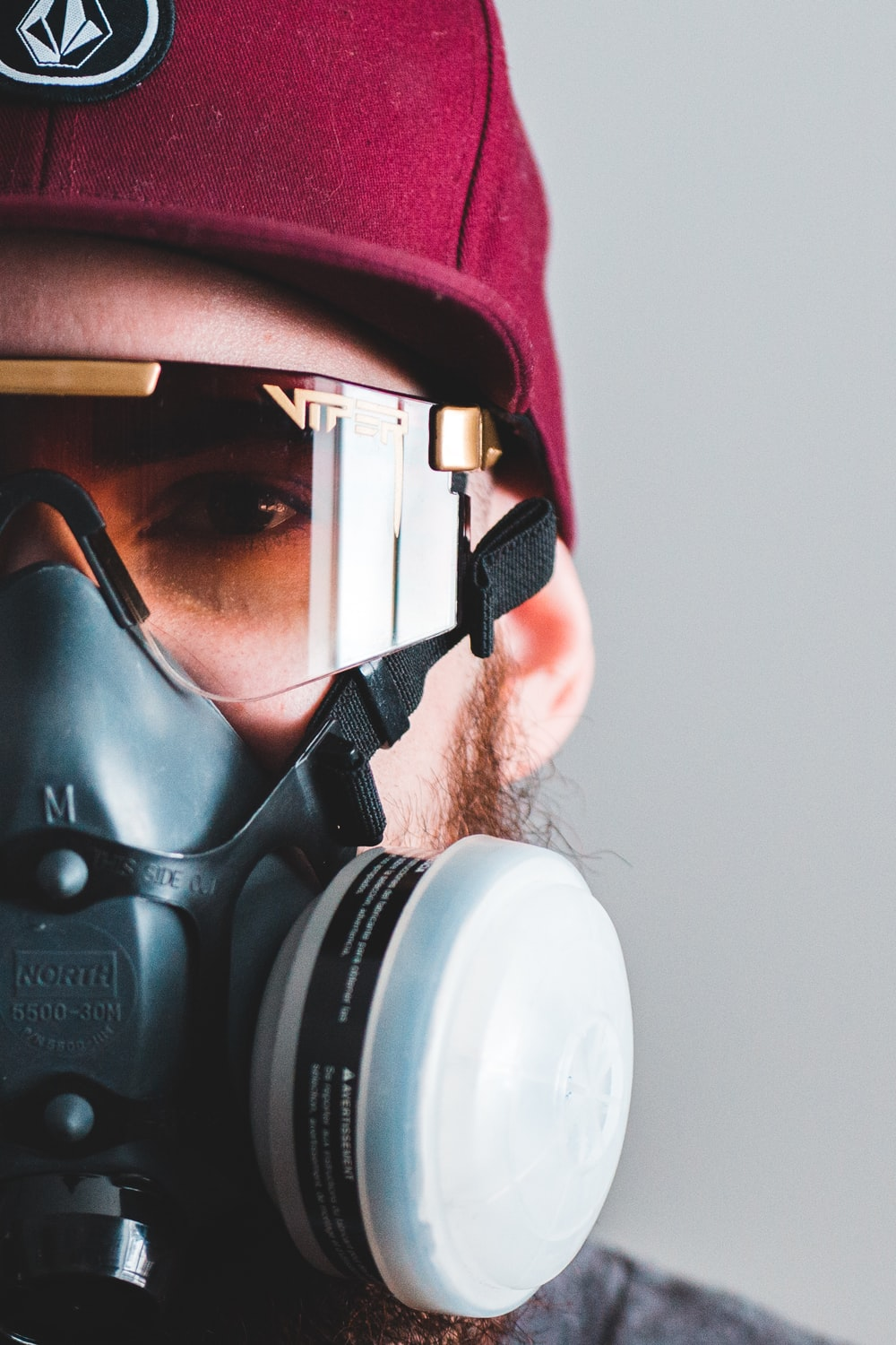 man in pink and black gas mask