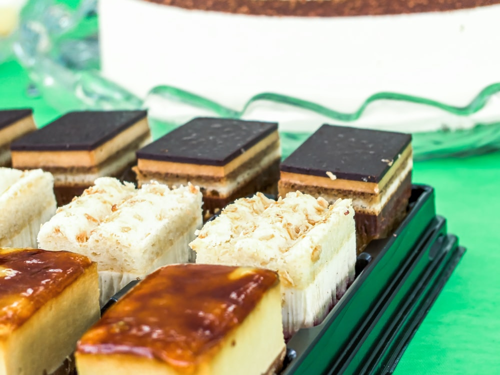 brown and white cake on green tray