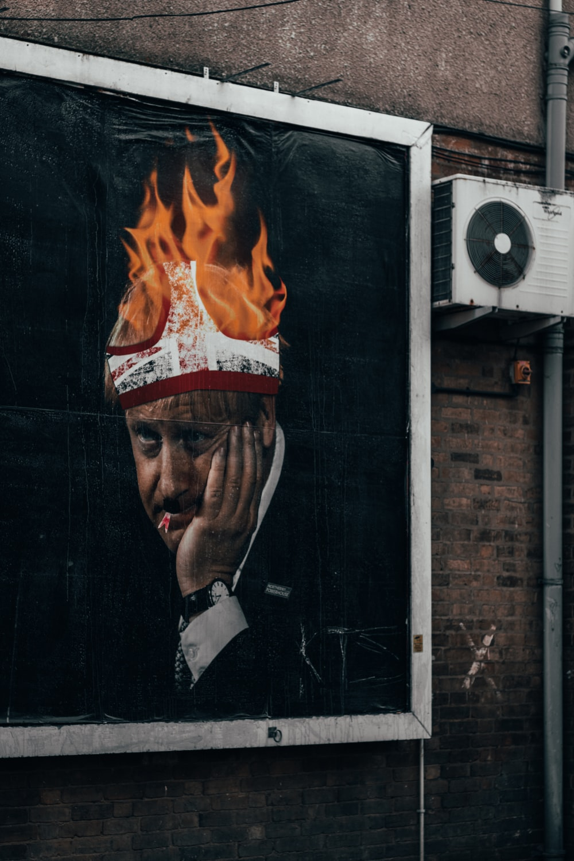 man in black suit jacket painting