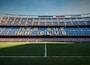 soccer field under gray sky