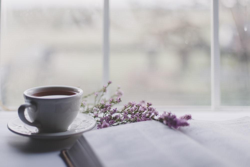 white ceramic teacup on white ceramic saucer on table