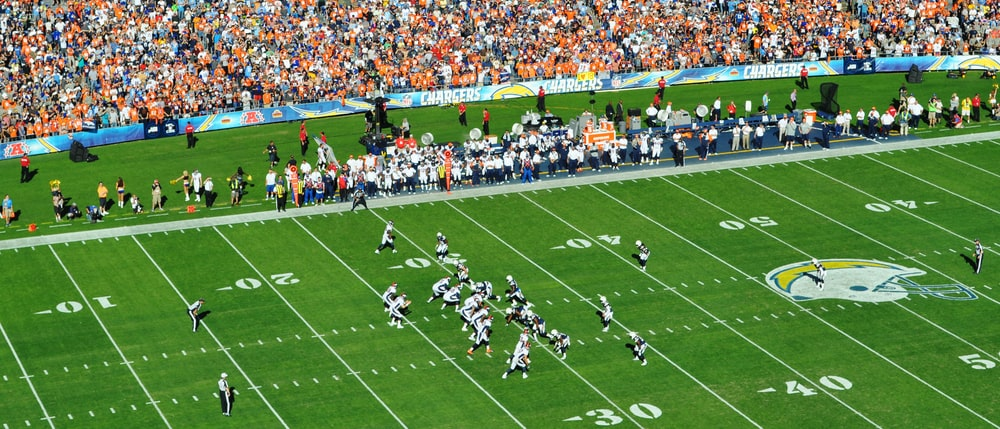 football players on green field during daytime