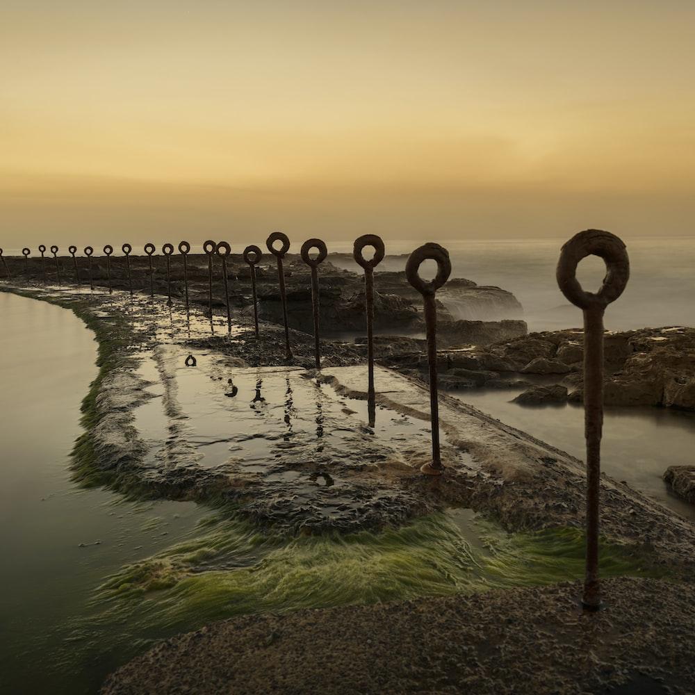 body of water near bridge during sunset