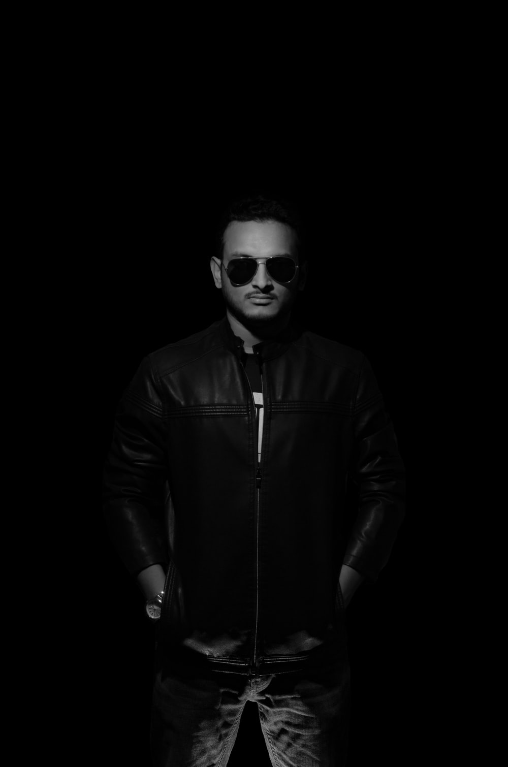 man in black leather zip up jacket wearing sunglasses