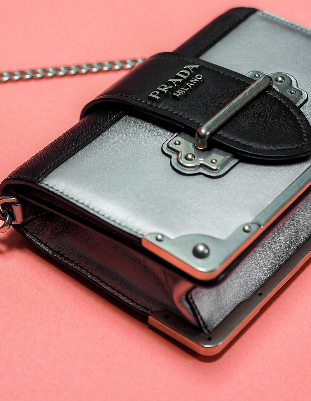 black leather case on red surface