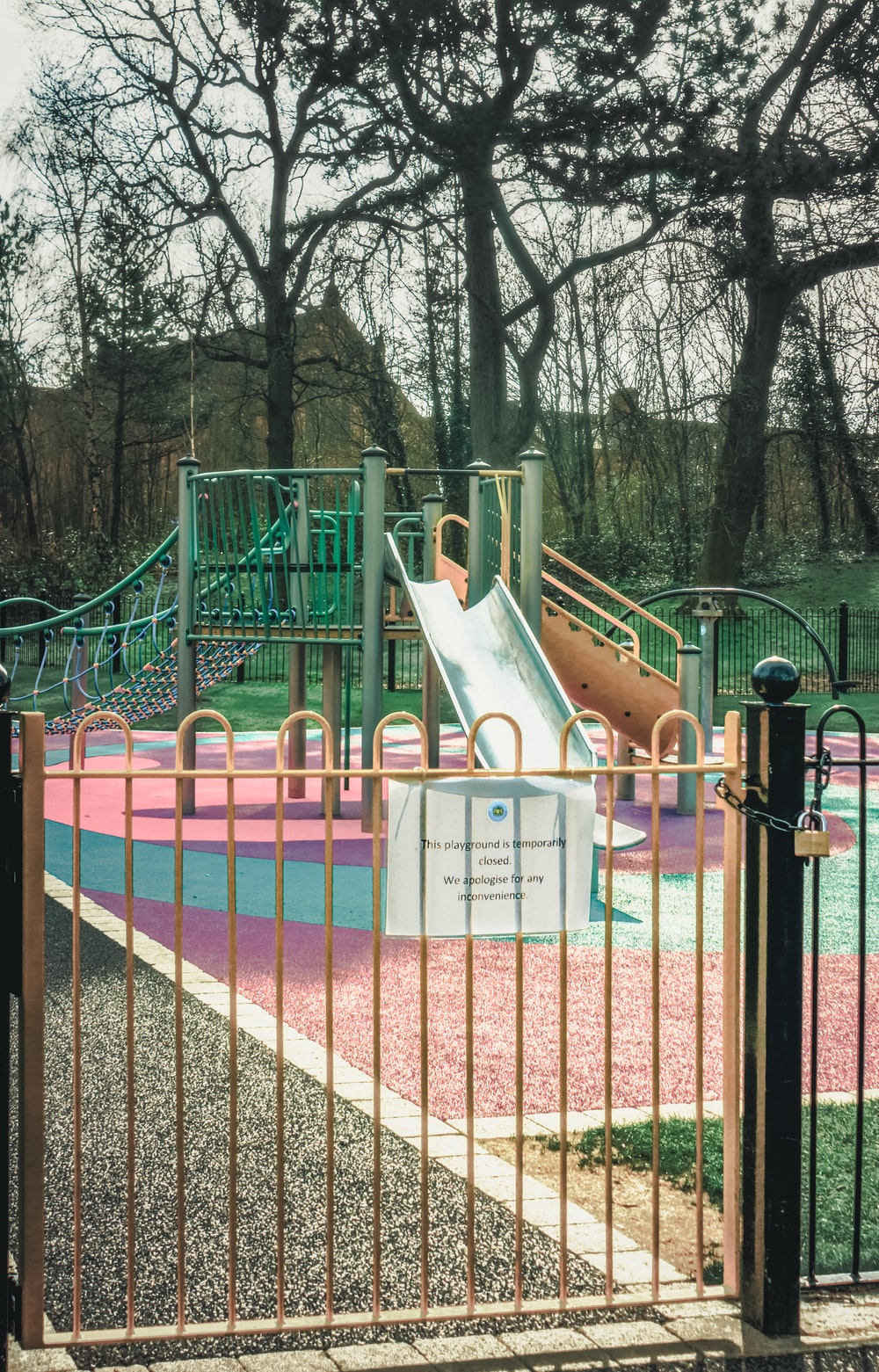 pink and white playground during daytime