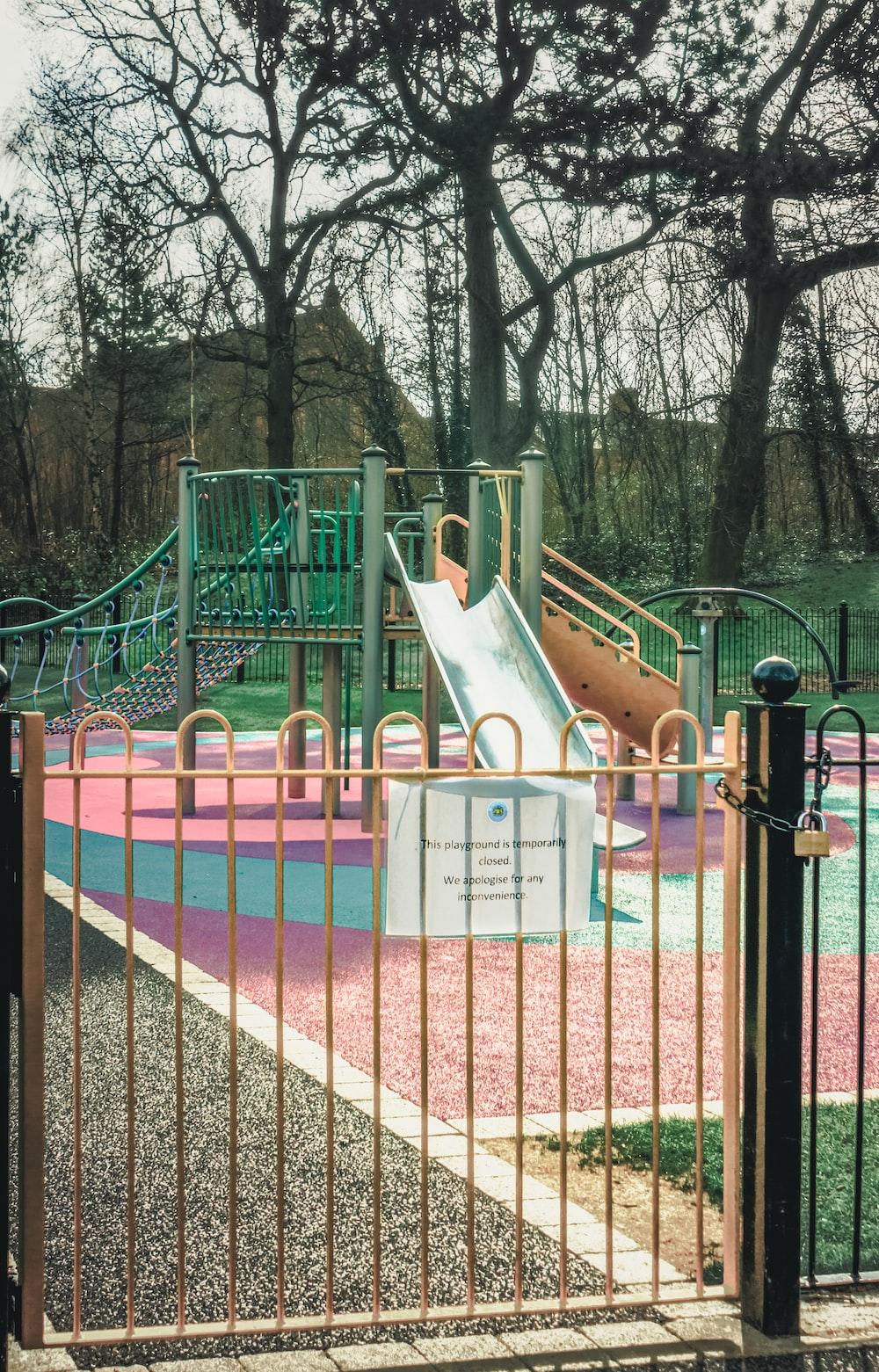 pink and white playground during daytime